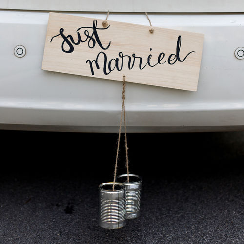 Wedding car with handmade plate JUST MARRIED Plate Hanging Out Wedding Car Just Married Handmade Message Social Issues White Color Service Transportation Architecture City Cleaning Car Black Color Close-up Sign Graffiti Day Indoors  Communication No People Western Script Text Motor Vehicle