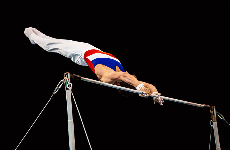 Low angle view of man performing acrobat