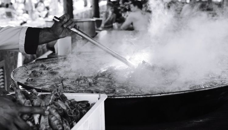 cooking in huge proportions #Vacation Cooking Chef Stir Pot Seafood Shrimp Cookout Eating Dominicanrepublic Sony Monochrome Close Up People Only Men Human Body Part Men Occupation Adult One Person Adults Only One Man Only Outdoors Human Hand Day Business Stories