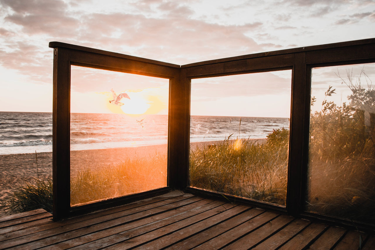 sea, water, window, sky, nature, sunlight, scenics, tranquil scene, sunset, tranquility, no people, luxury, indoors, architecture, day, beauty in nature