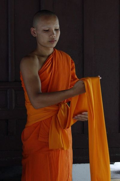 Monk getting his rob on. Luang Prabang Laos Photoart Monks In Temple EyeEmNewHere Photographicart Travel Destinations Travel Photography Luang Prabang, Laos Wat Buddhism Monks Robe Luangprabang Luang Prabang Monk  Monksrobs Orange Color Young Adult One Person Real People Lifestyles The Week On EyeEm