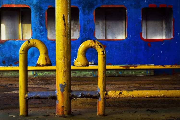 Detail of old decaying rusty barge boat in Holbox, Mexico Barge Decay Industrial Industry Mexico Yúcatan Boat Boats Deck Floating On Water Holbox No People Pipe - Tube Primary Colors Shipping