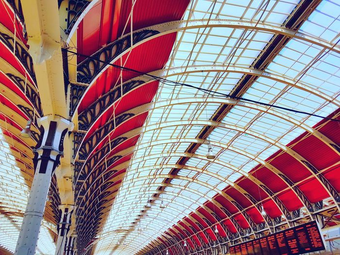 Arched Glass Roof of Paddington Station, London Low Angle View Indoors  London Architecture Transportation 1800s Building Sense Of Wonder Looking Up At The Sky Engineering Feat Striking Red Architecture Sky Light Glass Abstract Famous Building Close-up Built Structure Paddington Station Brunel Steel Structure  Red Roof Arch Columns Rethink Things EyeEmNewHere Be. Ready. AI Now EyeEmNewHere
