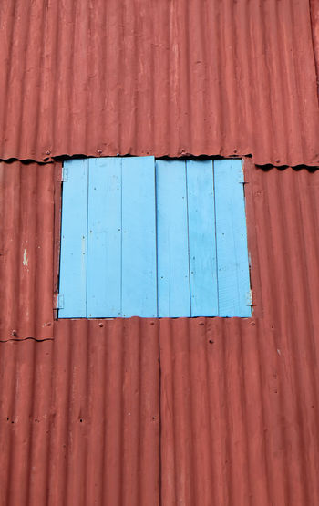 Old rustic folding old metal door gate. Architecture Backgrounds Brown Building Exterior Built Structure Cargo Container Corrugated Corrugated Iron Day Freight Transportation Full Frame Iron Metal No People Old Outdoors Pattern Sheet Metal Shipping  Textured  Wood - Material