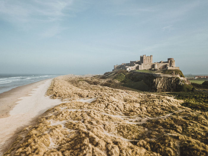 View of fort on beach against sky