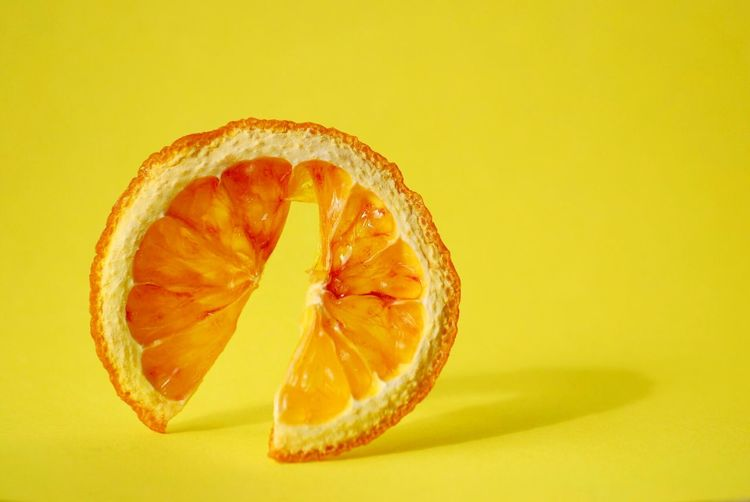 Yellow slice of dried orange EyeEm Best Shots Details Textures And Shapes Detail Minimalism Macro Dry Dried Fruit Citrus Fruit Food Food And Drink Fruit Citrus Fruit Yellow Freshness Healthy Eating Studio Shot SLICE Orange Color Wellbeing Indoors  Colored Background Yellow Background Orange Still Life No People Cross Section Close-up Orange - Fruit EyeEmNewHere EyeEmNewHere EyeEmNewHere EyeEmNewHere The Still Life Photographer - 2018 EyeEm Awards The Creative - 2018 EyeEm Awards