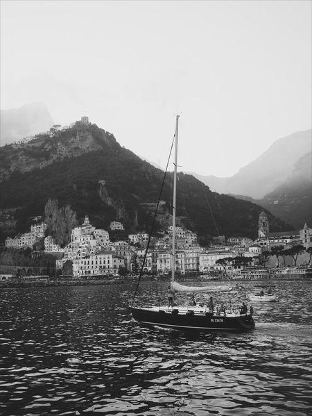 Mountain Water Mountain Range Nature Outdoors Tranquility Nautical Vessel Landscape ıtaly Travel Travel Destinations Amalfi Coast Boat Sailboat Monochrome The Traveler - 2018 EyeEm Awards