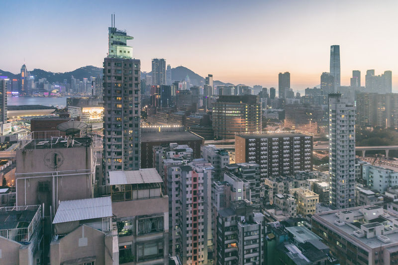 Hong Kong, China - 5 April 2015: Hong Kong Skyline at dusk Architecture Building Exterior Business Finance And Industry City City Life Cityscape Downtown District Dusk Hk Hong Kong Hong Kong City HongKong Illuminated Modern Night No People Outdoors Sky Skyscraper Sunset Travel Destinations Urban Skyline