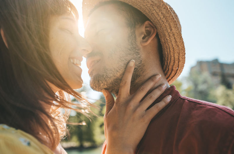Close-up of romantic couple during sunny day