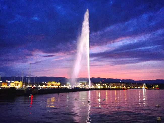 Water Night Cloud - Sky Sunset Illuminated Built Structure Outdoors Waterfront Travel Destinations No People City Fountain Jet D'eau Geneva Geneva Lake Lake Leman Europe Sky Is On Fire Clouds And Sky Lake Lake View City Lights Night Lights Spraying Jet D'Eau De Genève