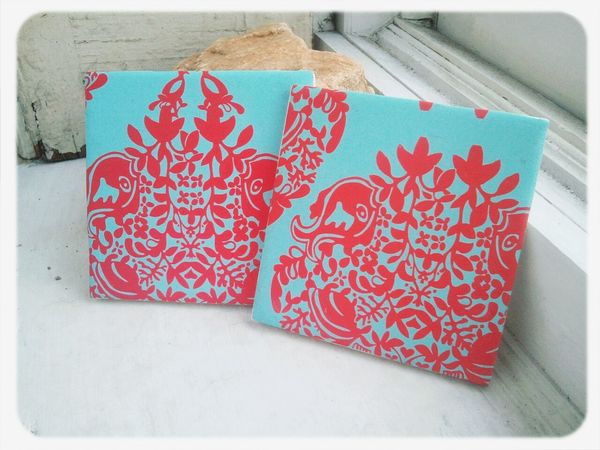 Handmade decorative red and blue design coasters availavle at https://www.etsy.com/shop/lilacandlemon Peace And Quiet Handmade Housewares Coasters