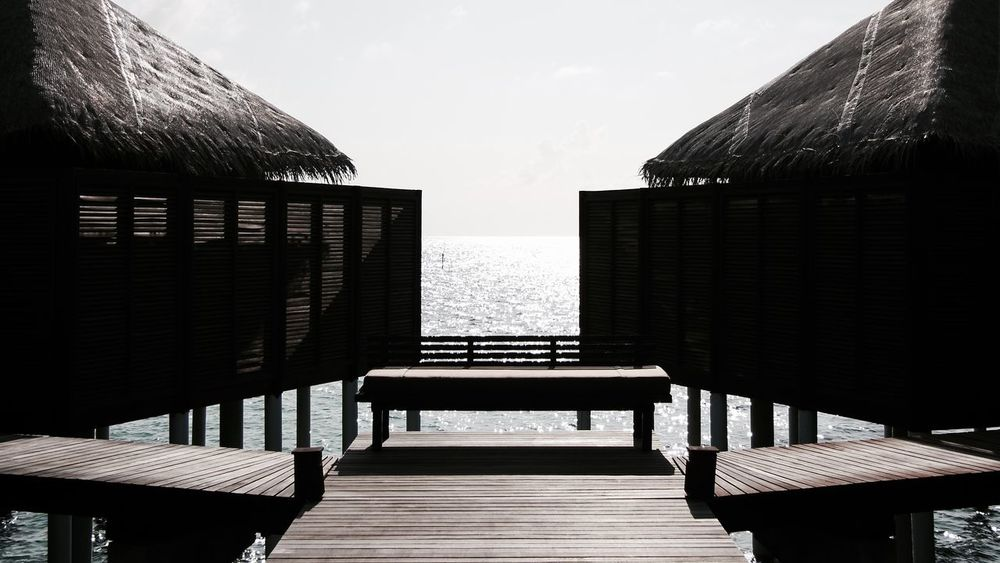 scenic view of a water village on the maldives Architecture Bench Bridge Built Structure EyeEm Best Shots Indian Indian Ocean Maldives Nature Outdoors Railing Reflection Scenic View Scenics Life Design Sky Sunshine Symetry Light Thatched Roof Travel Water Watervillage Wooden Been There. Modern Hospitality