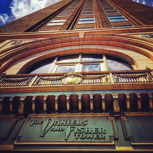 Denver Colorado  Denver Denver,CO Downtown Tall Building Text Architecture Low Angle View Built Structure History Day No People Travel Destinations Building Exterior Indoors  Sky Close-up