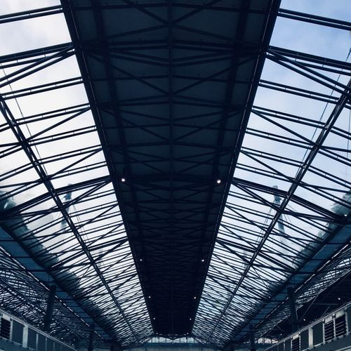 ShotOnIphone Railway Station Helsinki Helsinki,finland Finland Helsingborg  Architecture Low Angle View Ceiling Indoors  Built Structure Pattern No People Architectural Feature Metal Glass - Material Railroad Station Building Lighting Equipment Sunlight Modern Roof Day Skylight Illuminated Girder
