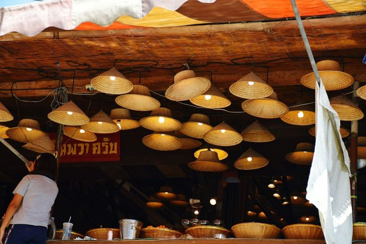 Low angle view of illuminated lanterns hanging on table at restaurant