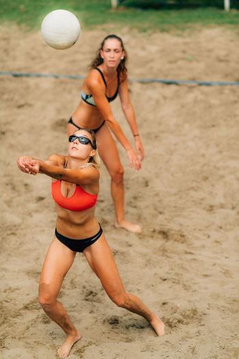Beach volleyball player hitting the ball