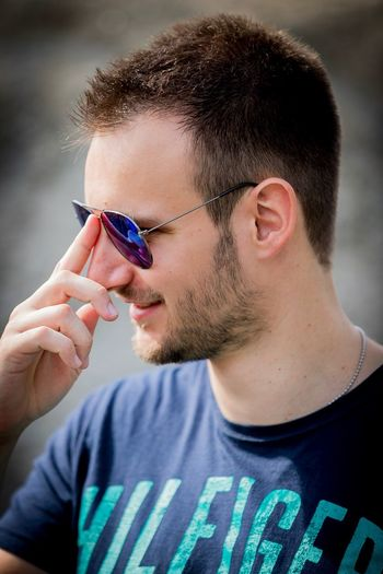 Close-up portrait of young man wearing sunglasses
