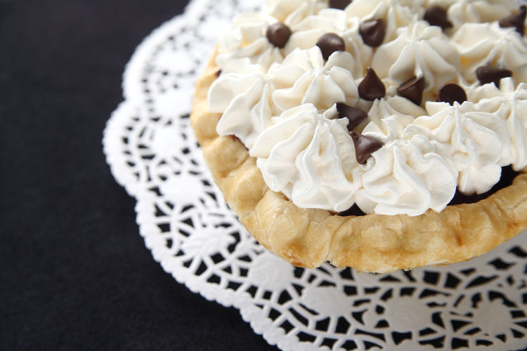 Close-up of pie with whipped cream and chocolate chips