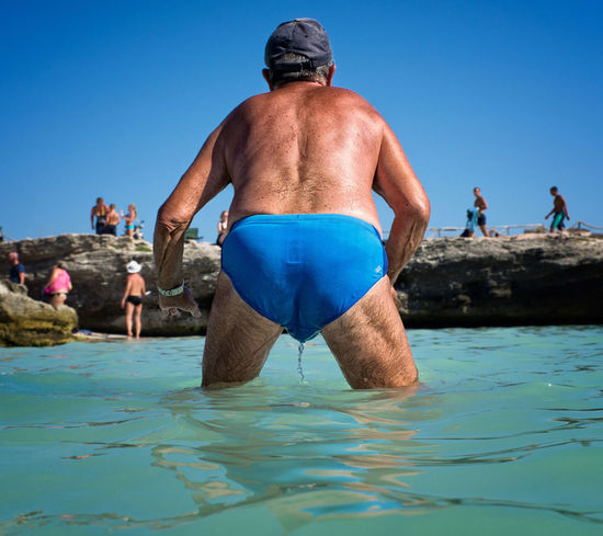 The sea catcher Blue Clear Sky Italy Men One Person Real People Sea Summer The Street Photographer - 2017 EyeEm Awards Vacations Water