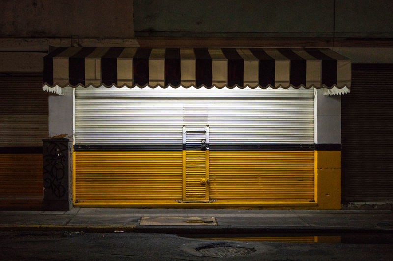 Closed shutter of store at night