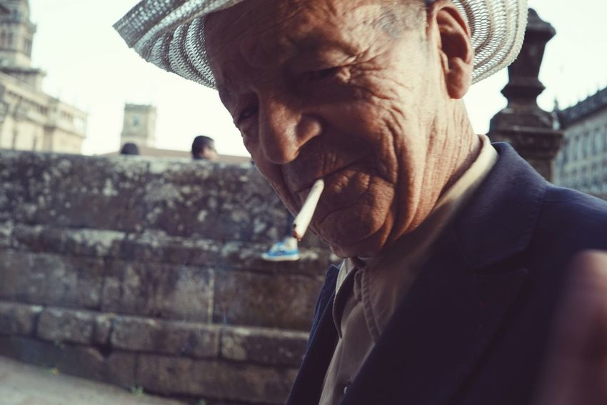 Up Close Street Photography The Way Cityscapes CaminodeSantiago Europe Mayor Oldman In Camino Backpacking Travel Photography Magic Hour Walking España Streetphotography Man Fumar Cigarette  City Life Cityscape