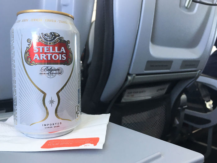 Brussels, Belgium - 15 August 2017: Aluminum can of Stella Artois on a white napkin sitting on folding seat tray in economy class during a Brussels Airlines flight. Can of beer on a flight. AirPlane ✈ Flights Stella Artois Stella ❤ Airplane Airplanes Brussels Airlines Brussels Belgium Flight Flight ✈ Stella Stellaartois