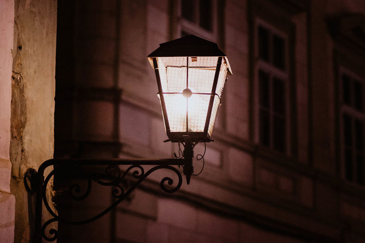Close-up of illuminated lamp on wall