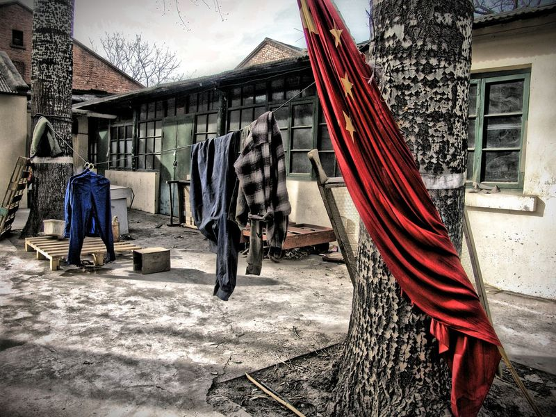 Chinese Flag and Laundry China Chinese Flag Communism Laundry Street Photography Streetphotography ASIA Chinese People Portrait Of Bejing Chinese Culture