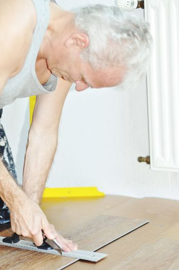 Senior man working on table at home