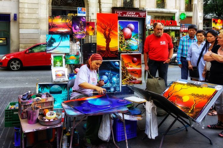 Street artist Arts Culture And Entertainment Real People Technology Performance Wireless Technology Communication Multi Colored Outdoors Day Crowd People Men
