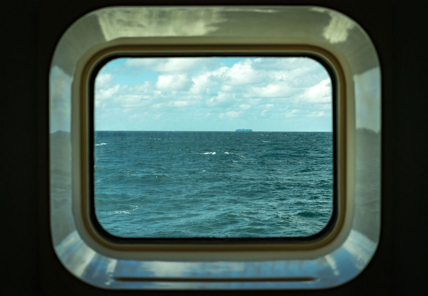 The Partner Collection The EyeEm Collection Bunk Channel Cruise Ship English Channel Porthole Travel Cloud - Sky Day Glass - Material Horizon Horizon Over Water Indoors  Mode Of Transportation Nature Nautical Vessel No People Ocean Sea Ship Sky Transparent Transportation Travel Vehicle Interior Water Window My Best Travel Photo