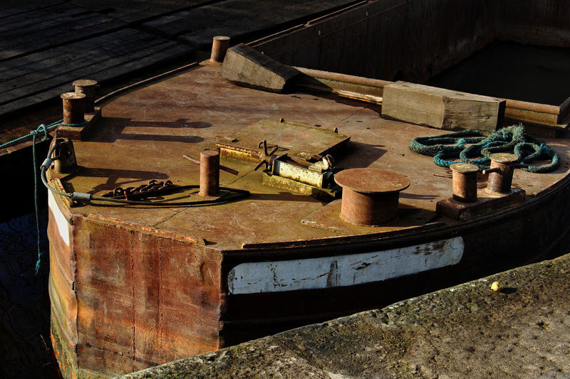 Rusty old barge [still working] Rope Shadows & Lights Working Boat Abandoned Bow Of A Barge Bow Of A Boat Built Structure Chains Container Damaged Day Decline Deterioration High Angle View Metal Moored Barge Mooring Post No People Old Rusty Still Life Sunlight Wood - Material Wood Planks Working Barge