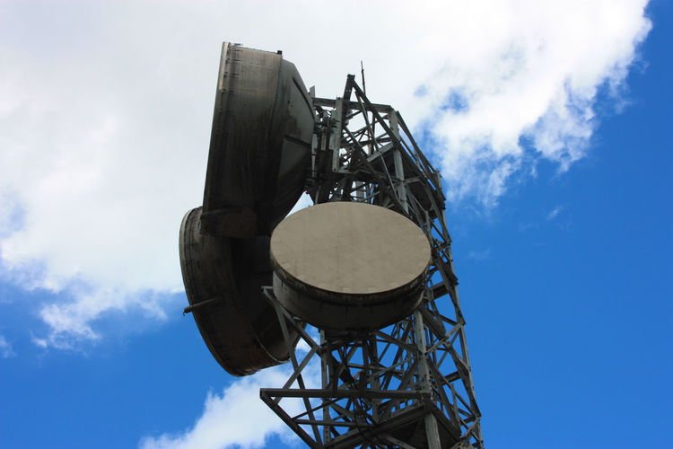 High large antennas transmitting signals with current satellite dishes