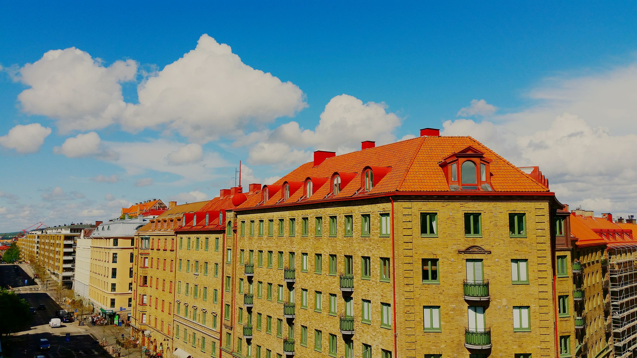 architecture, building exterior, built structure, sky, cloud - sky, window, cloud, residential structure, blue, low angle view, residential building, city, building, day, outdoors, house, exterior, no people, cloudy, sunlight