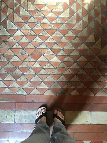 Floor Flooring Low Section Human Leg Personal Perspective Standing Real People Pattern Indoors  Multi Colored High Angle View Tiled Floor Medieval Architecture Ancient Floor Decoration