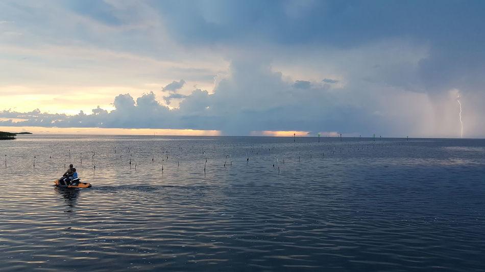 Escape. Magnificent View Sunset In The Gulf Stromy Lightning Storm Lightning Bolt Nightfall Nightfall In The Gulf Clouds Clouds & Sky Cloud - Sky Cool Lighting Effect Jetski Jetski Ride Jetskiing