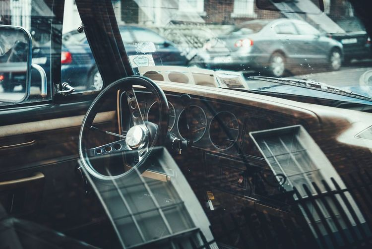 Close-up of vintage car in city