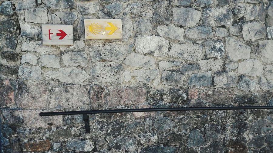 Camino De Santiago Way Of Saint James Muro  Barandilla Wall Sign Exit Sign Rock Wall Rock Wall Texture Señales