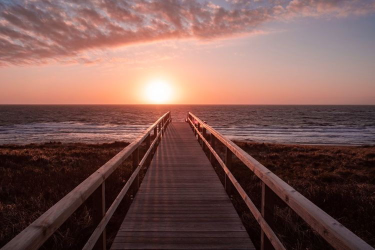 Sylt EyeEm Selects Sylt Sky Sea Horizon Horizon Over Water Water Scenics - Nature Beauty In Nature Sunset Beach Tranquil Scene Land Tranquility The Way Forward Direction Nature Wood - Material Idyllic Diminishing Perspective Railing Outdoors