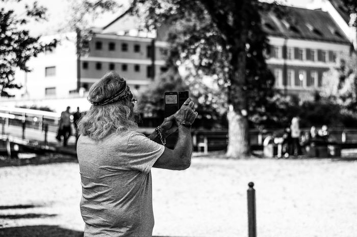 Blackandwhite Casual Clothing City City Life Day Focus On Foreground Grunge Hobbies Incidental People Leisure Activity Lifestyles Looking Memories Outdoors Person Photographer Rear View Standing Street Streetphotography Three Quarter Length