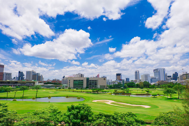 golf course in bangkok Architecture Bangkok Blue Sky Bluesky Building City Cloud Golf Course Grass Green Green Sward Greensward Large Lawn Metropolis Nature Plant Sky Sward Thailand Tree Vast Wide