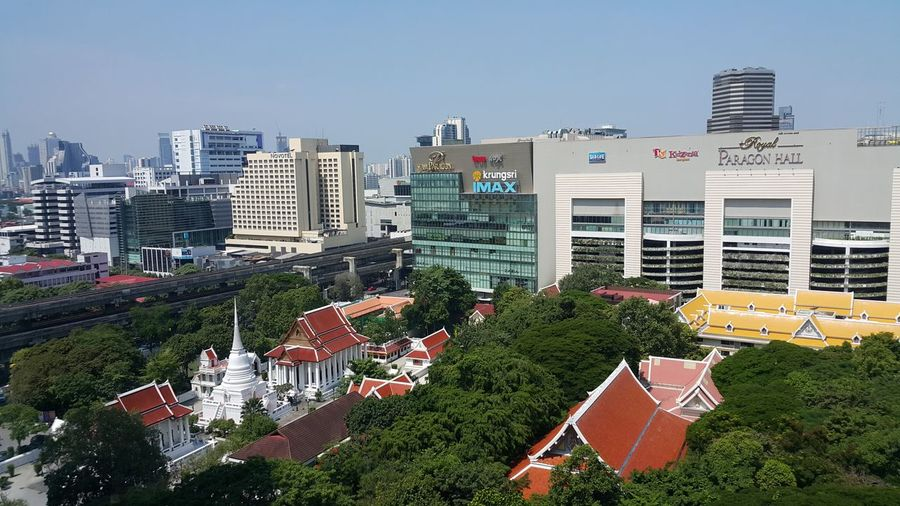 Skyscraper High Angle View City Building Exterior Architecture Modern Downtown District No People Cityscape Apartment Urban Skyline Outdoors Built Structure Tree Office Clear Sky Illuminated Day Sky Buddist Temple วัดปทุมวนาราม