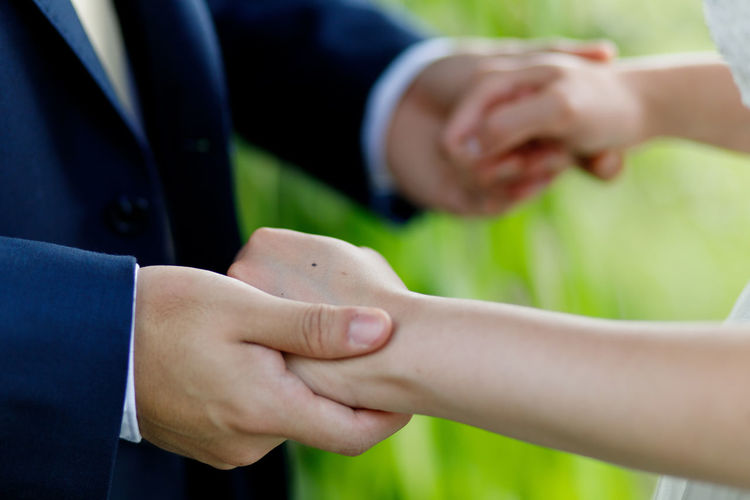 Hold my hand, togetherness concept Hand Human Hand Human Body Part Two People Togetherness Adult Midsection People Women Day Ring Men Jewelry Focus On Foreground Well-dressed Females Close-up Wedding Holding Hands Bride And Groom Wedding Relationship SUPPORT Love My Best Photo