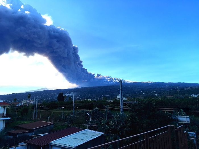 Mount Etna eruption, 24th of December 2018 Eruption EyeEm Nature Lover EyeEmNewHere EyeEm Best Shots Italy Volcano Mount Etna Sicily Sky Smoke - Physical Structure Cloud - Sky Building Exterior Nature Pollution Architecture Built Structure No People Mountain
