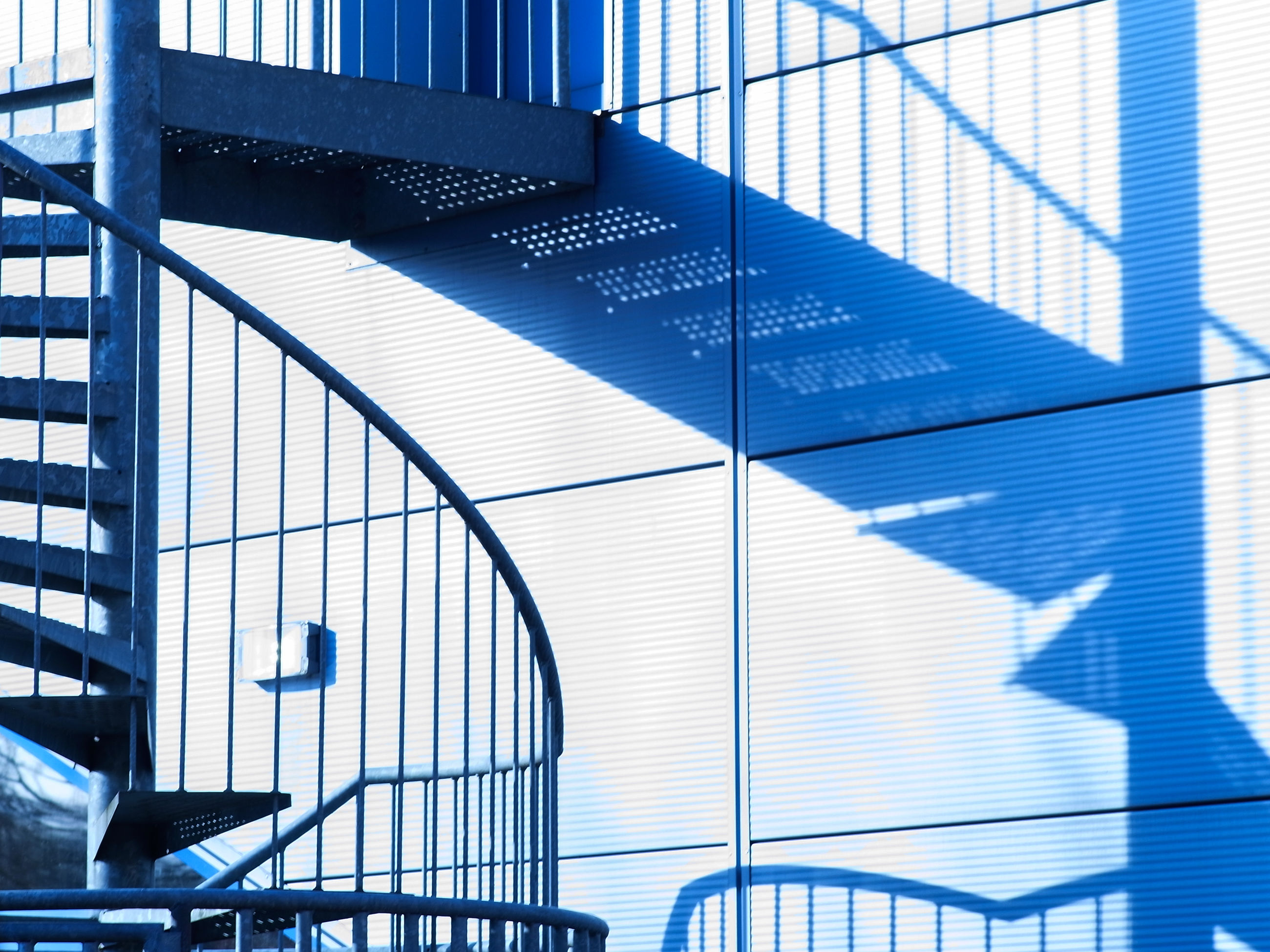 staircase, steps and staircases, architecture, railing, steps, built structure, no people, indoors, building exterior, spiral staircase, modern, day