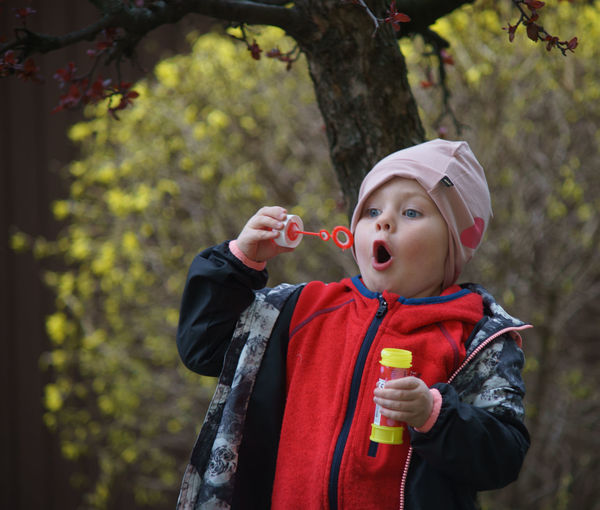 Casual Clothing Childhood Children Photography Cute Day Focus On Foreground Jacket Leisure Activity Lifestyles Outdoors Person Portrait Soap Bubbles Tree Warm Clothing