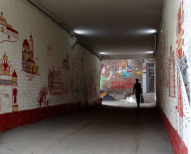 Graffiti Indoors  Architecture Built Structure One Person Full Length Multi Colored People Adult Day Light Architecture Travel Destinations City Street City