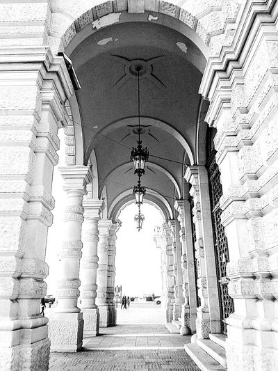 Street Architecture Blackandwhite Sky Day Outdoors Lamps Trieste Arch No Filters  Archway Smartphonephotography No People Built Structure Architectural Column