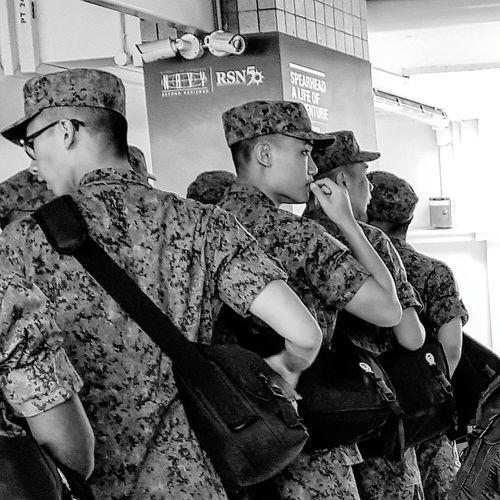 NSmen Going Into Camp Sg_streetphotography Streetphotography Bnwstreetphotography Bnwsingapore Bnwphotography Camo Uniform Pasir Ris Bus Interchange Singapore