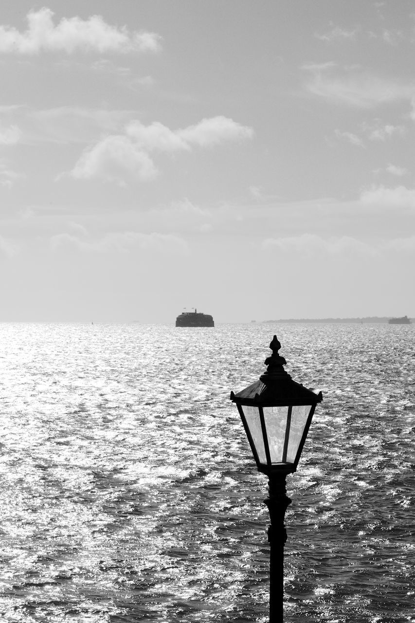 sea, lighting equipment, horizon over water, water, nature, scenics, street light, tranquility, sky, outdoors, tranquil scene, gas light, beauty in nature, cloud - sky, day, no people